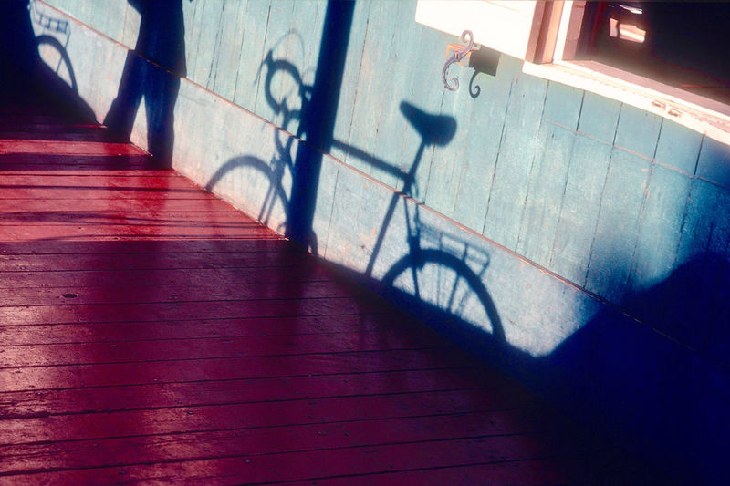 Shadow Architecture Railing Sunlight Indoors  Day Flooring Bicycle Motion High Angle View Staircase Real People Nature Blurred Motion One Person Built Structure Wall - Building Feature Building Focus On Shadow Bike Shadow Terrace