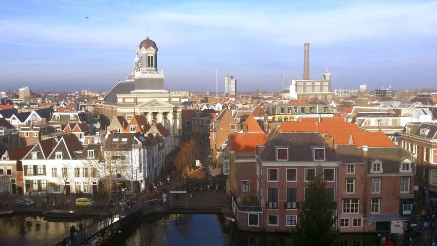 Skyline of the city of Leiden Travel Architecture Travel Destinations Tower Cityscape City Urban Skyline Built Structure Horizontal Tranquility Building Exterior Arrival Business Finance And Industry Industry Outdoors Water Leiden Sky Holland Netherlands Church City City Life Cityscape Channel