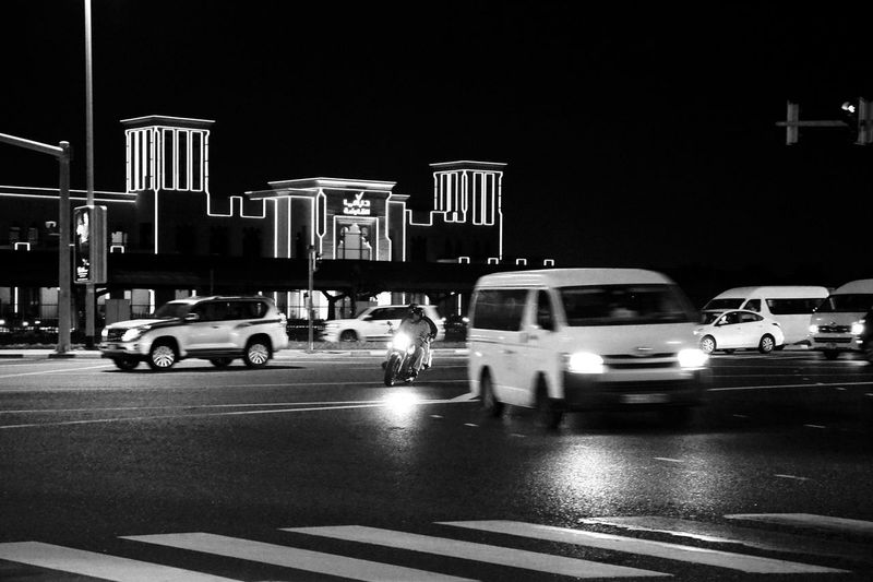 Captured Moment Dubai Motor Vehicle Car Transportation Mode Of Transportation Land Vehicle City Road Street Night Architecture Built Structure on the move Road Marking City Life Traffic Motion