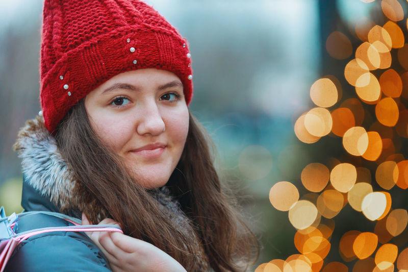 Portrait of girl holding shopping bag in store
