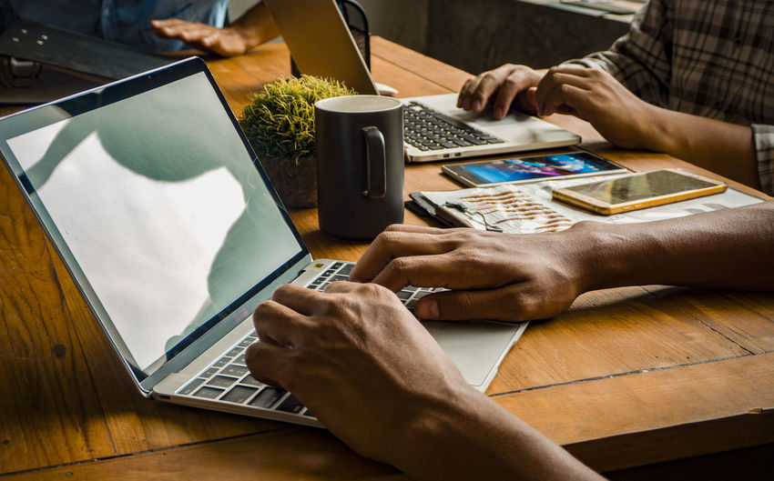Common work practices Concept. Technology Wireless Technology Laptop Communication Connection Computer Portable Information Device Business Mobile Phone Using Laptop Surfing The Net