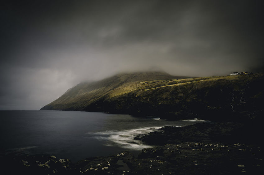 Life on the edge. Location: Viðareiði, Faroe Islands Equipment: Fujifilm X-T2 + XF14 F2.8 R www.instagram.com/nils_leithold Atmosphere Beauty In Nature Cloud - Sky Faroe Islands Fujifilm Globetrotter Horizon Over Water Landscape Moody Mountain Nature Night No People Outdoors Power In Nature Scenics Sea Sky Storm Storm Cloud Tranquil Scene Tranquility Viðareiði Wanderlust Water