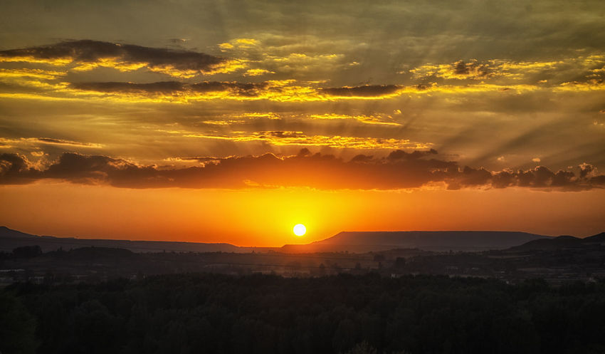 Beauty In Nature Bright Cloud Cloud - Sky Countryside Dramatic Sky Idyllic Landscape Majestic Mountain Mountain Range Nature No People Non-urban Scene Orange Color Outdoors Remote Scenics Sky Sun Sunset Sunset_collection Tranquil Scene Tranquility Vibrant Color