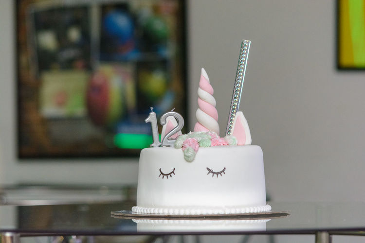 Close-Up Of Birthday Cake On Table At Home