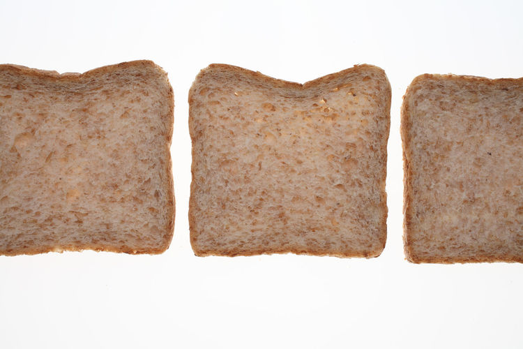 slices of Wholemeal toast bread on white Arrangement Bread No People Non-urban Scene Shore Slices Studio Shot Toastbread Toast🍞 Tranquility White Background Wholemeal Wholemeal Bread