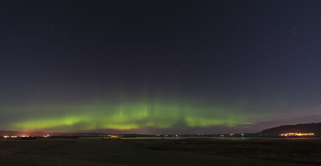 Northern lights captured over Loch Leven, Kinross, Scotland Loch Leven Northern Lights Astronomy Aurora Polaris Beauty In Nature Galaxy Illuminated Nature Night No People Outdoors Scenics Sky Star - Space Tranquil Scene Tranquility Water