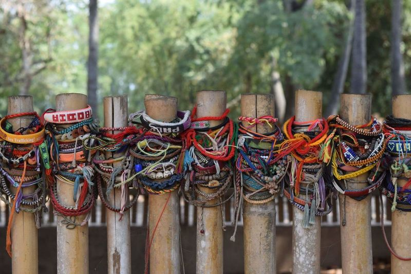 Close-up of bracelets on fence