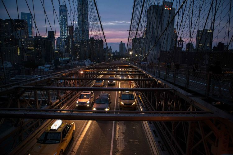 High angle view of cars on bridge in city at night