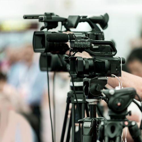 Close-up of television cameras