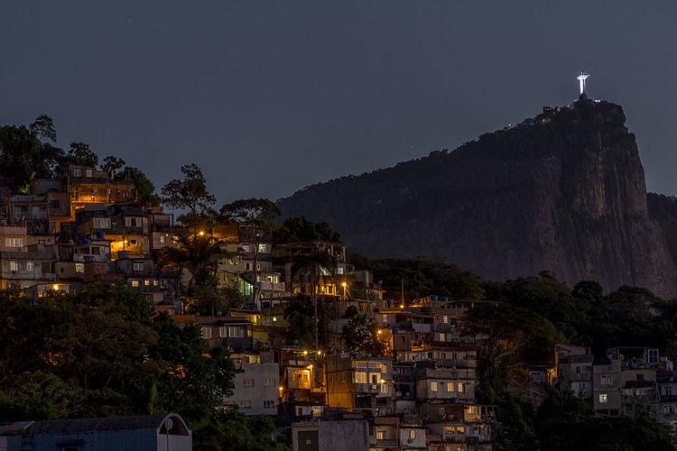 View of Christ the Redeemer from the favela Vidigal before sunrise Brazil Christ The Redeemer City Cityscape Cityscape Favela Favelabrazil Favelas Illuminated Latinoamerica Night Rio De Janeiro Slum South America Travel Destinations Vidigal