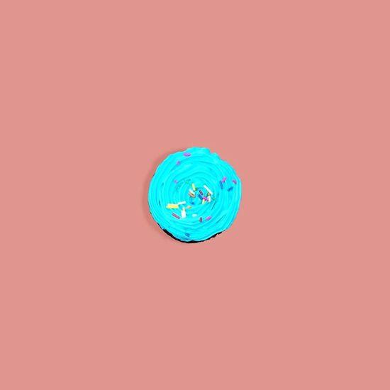 Cupcake. Sprinkles Rainbow Minimalistic Foodporn Visual Creativity Foodphotography Food Pastry Cupcake Blue Minimalism Minimal Minimalist EyeEm Best Shots EyeEmNewHere EyeEm Gallery EyeEm Selects EyeEmBestPics Peach Studio Shot Colored Background Concentric Complexity Innovation Close-up Pink Background Red Background Colorful Geometric Shape Pattern