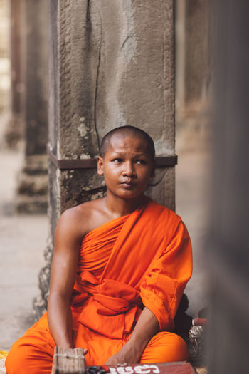 Portrait of man sitting in temple