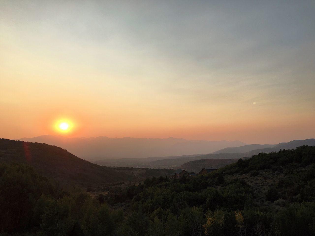 sky, sunset, scenics - nature, beauty in nature, mountain, tranquility, tranquil scene, landscape, environment, non-urban scene, sun, idyllic, nature, orange color, mountain range, no people, outdoors, land, plant, sunlight
