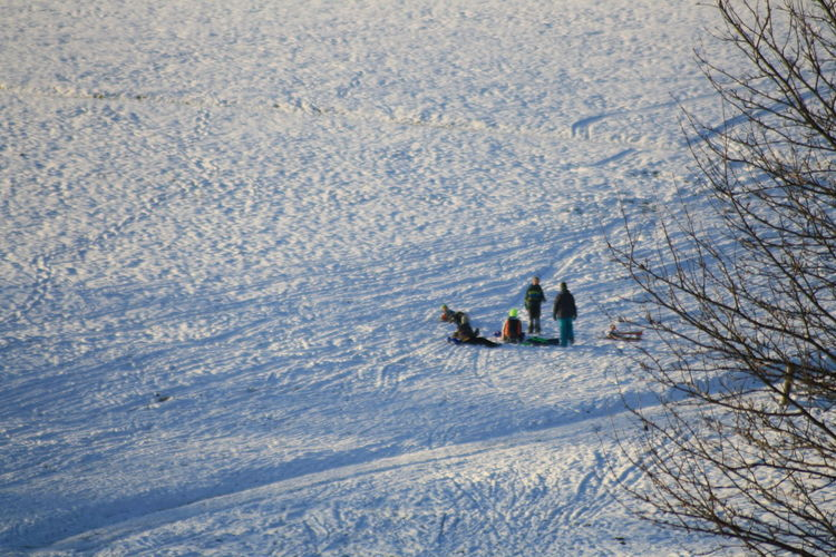 High angle view of people on snow covered land
