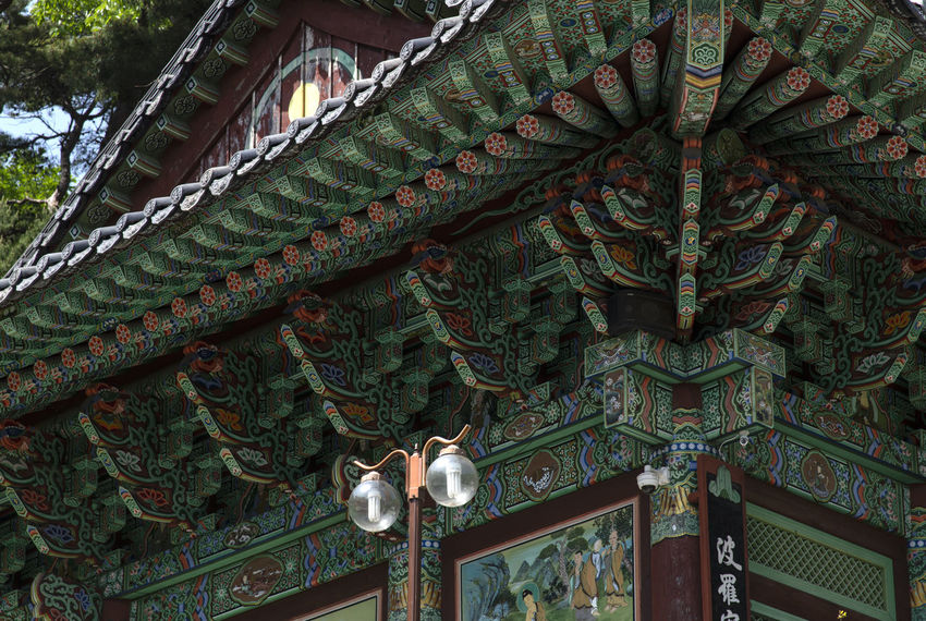 view of Bomunsa, a famous Buddhism temple at Seokmodo in Ganghwado, Kimpo, Gyeeonggido, South Korea Bomunsa Buddhism Temple Seokmodo Architecture Art And Craft Belief Buddhism Building Building Exterior Built Structure Craft Creativity Day Ganghwado Lighting Equipment Low Angle View No People Ornate Outdoors Place Of Worship Religion Religious  Representation Sculpture Spirituality Statue Temple
