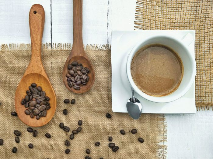 Ceramic set of hot coffee and coffee beans in wooden spoon on burlap sack with white wooden table floor, top view with space Ceramic Set Wooden Burlap Sack Top View Flat Lay Arrangement Decoration Hot Drink Textile Pattern Texture EyeEm Selects Drink Coffee - Drink Table High Angle View Close-up Food And Drink Ground Coffee Coffee Bean Espresso Sweet Mocha Caffeine Raw Coffee Bean Cappuccino Saucer Coffee Spoon