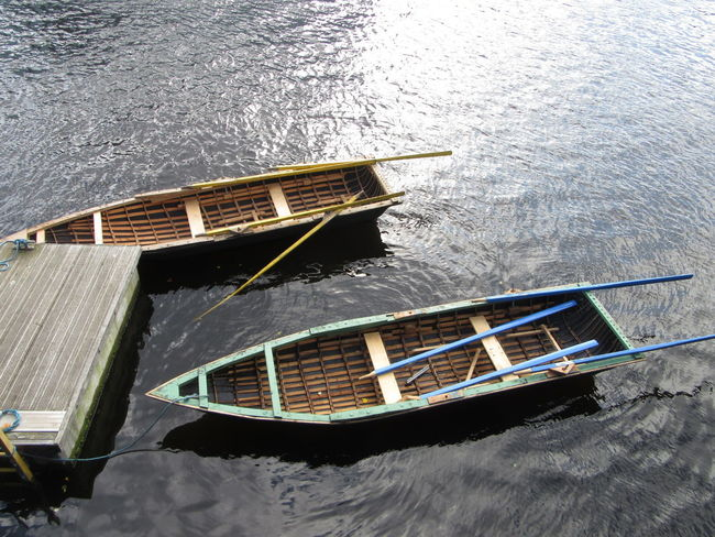 Currachs - traditional Irish wood framed & tarred canvas boats Transportation Nautical Vessel High Angle View Dramatic Angles Mode Of Transport Boat Water Day Outdoors No People Currach Dock Dockside Rowing Rowingboat River Lee Cork City Ireland An Eye For Travel