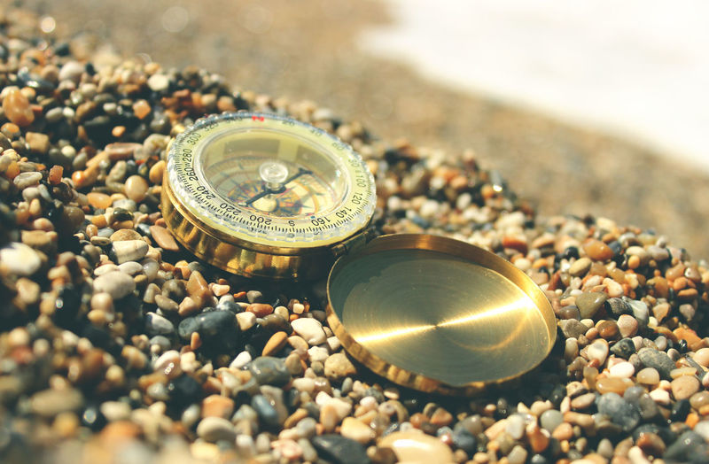 Close-up of clock on pebbles