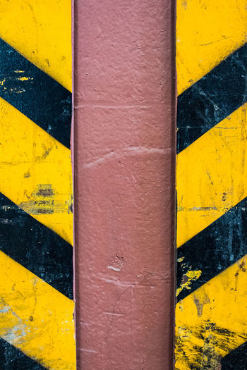 Detail shot of yellow painted wall