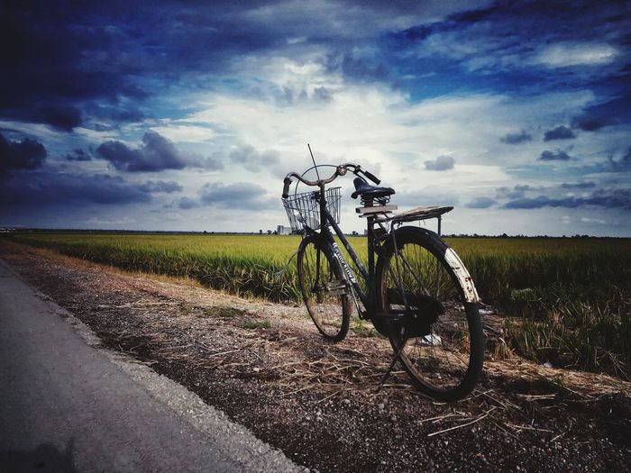 Bicycle Cloud - Sky Landscape Transportation Sky Outdoors Agriculture Rural Scene No People Day Nature Scenics Grass