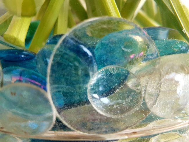 different Glasperls in a Vase Glasspearl In A Vase Blue Glass Waterpearls Low Angle View Reflection Special Effect Flower Stalks Green Shimmering