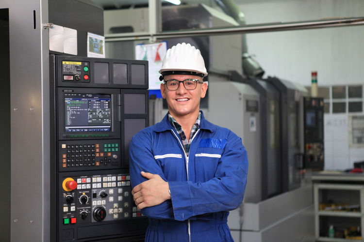 Portrait of smiling young man in factory