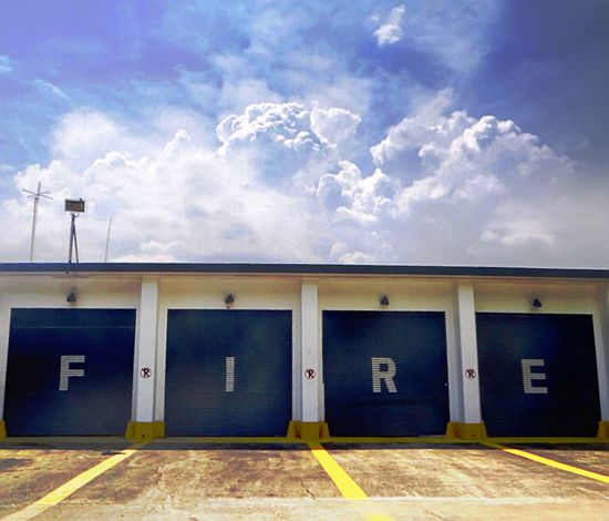 FIRE.. Fire Abandoned Firestation American Base Building Exterior Built Structure Sliding Door Architecture Cloud - Sky Blue Sky White Clouds Sunnyday Outdoors No People Shutter Door