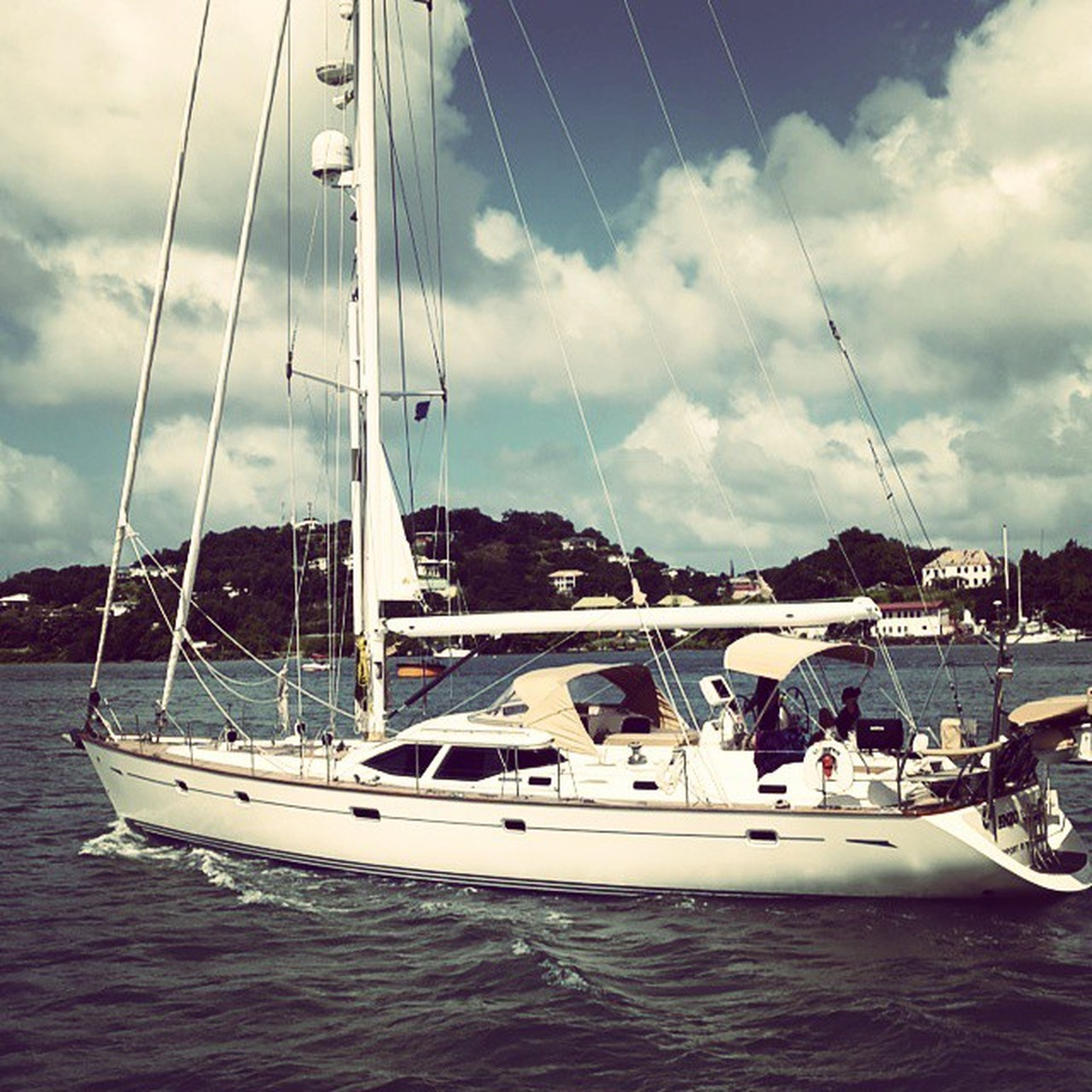 nautical vessel, boat, transportation, water, sky, mode of transport, cloud - sky, moored, sea, cloudy, sailboat, cloud, waterfront, mast, travel, mountain, harbor, day, nature, sailing
