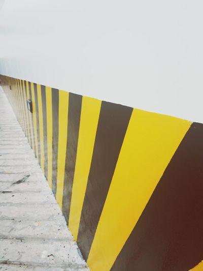 Yellow Day Outdoors Close-up Bricks Wall Warning Leading Road