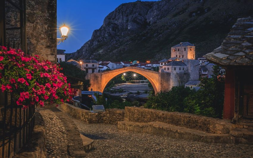 Old town Mostar Bridge Bosnia And Herzegovina Mostar Nightphotography Night Architecture Arch Built Structure Illuminated Building Exterior Outdoors Nature No People Plant Flower Travel Destinations Beauty In Nature Water