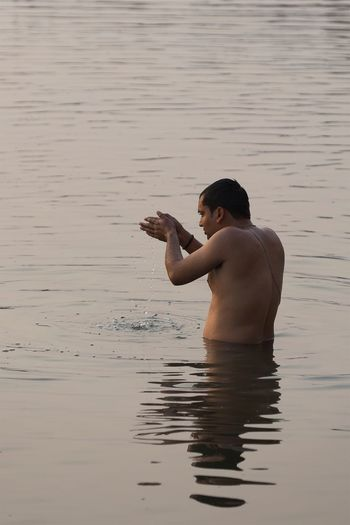 Morning bathe and prayer in the Ganges river. Varanasi on January 20, 2017. Lifestyles People Check This Out Storytelling India Travel Ganges River Documentary River Incredible India Cultures Indian Travel Photography EyeEm Best Shots - People + Portrait People Photography Real People Streetphotography Street Photography Religion Spirituality Portrait Hinduism