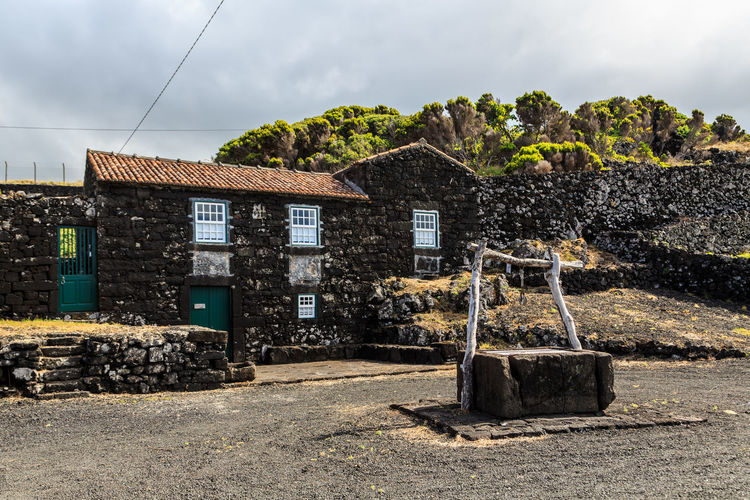 Azores Pico Island Abandoned Architecture Basaltic Rock Building Building Exterior Built Structure Cloud - Sky Damaged Day History House Land Nature No People Old Outdoors Ruined Run-down Sky Stone Wall The Past Tipical House Tree