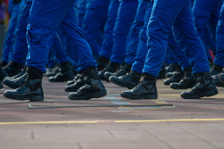 Blue Body Part City Clothing Crowd Day Government Group Of People Human Body Part Human Foot Human Limb Large Group Of People Low Section Men Military Motion Outdoors Real People Responsibility Shoe Street Togetherness Uniform