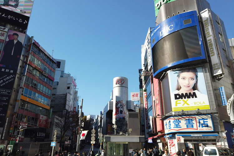 Urban Winter Street City Shibuya Tokyo Japan Shibuya Crossing Shibuya109 Building Exterior Built Structure Architecture Sky Day Low Angle View Clear Sky Looking At Camera Portrait Real People Advertisement One Person Building Nature Outdoors Child Women Childhood
