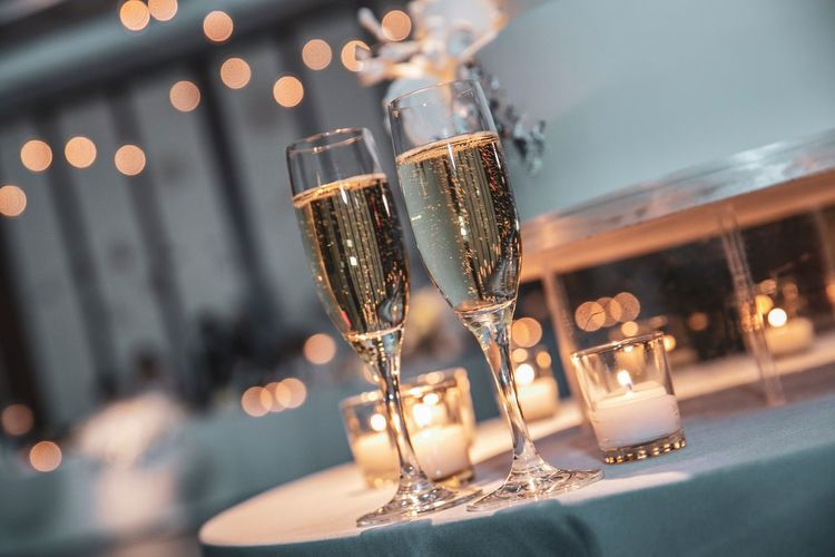 Close-up of champagne flutes on table at restaurant