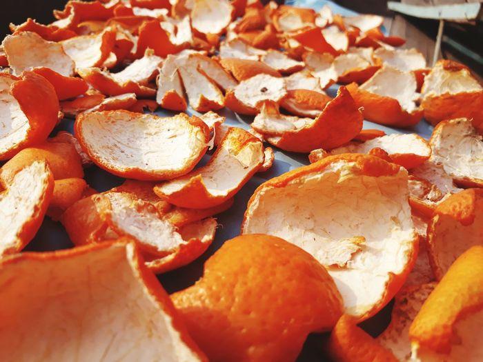 Full Frame Shot Of Orange Peels Drying On Table