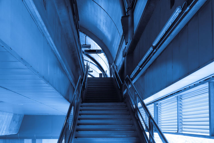 Feeling the blues on a Monday Staircase Architecture Steps And Staircases Low Angle View Railing Indoors  Modern Built Structure No People Moving Up Day Transportation Motion Direction Futuristic Blue Escalator The Way Forward Business Ceiling