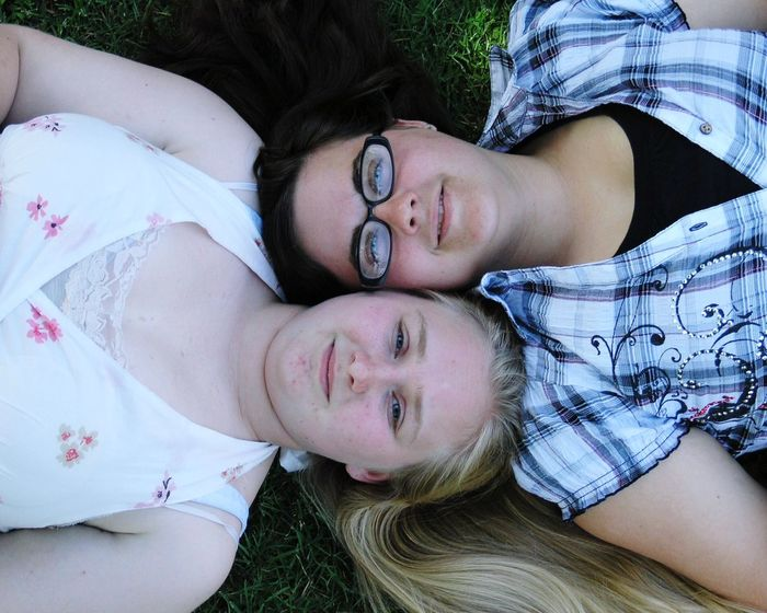 Lying Down Looking At Camera Real People Lying On Back Portrait Girls Leisure Activity Togetherness Smiling Happiness High Angle View Young Women Outdoors The Portraitist - 2018 EyeEm Awards