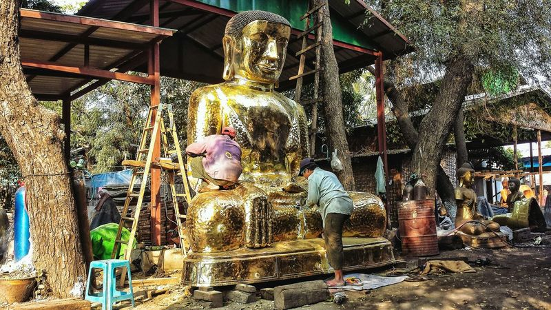 Bronze Smith where Buddha images are cast. Bronze Smithy Forge  Craftsman Low Angle Outdoors Southeast Asia Central Myanmar Burma Central Burma ASIA Afternoon Buddhism Buddhist Buddha Statue မြန်မာ မန္တလေး Mandalay Region