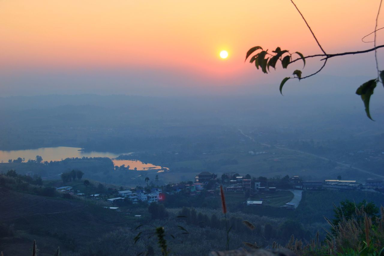 sunset, mountain, city, nature, cityscape, sky, beauty in nature, architecture, sun, outdoors, no people, scenics, landscape, building exterior, built structure, tree, day