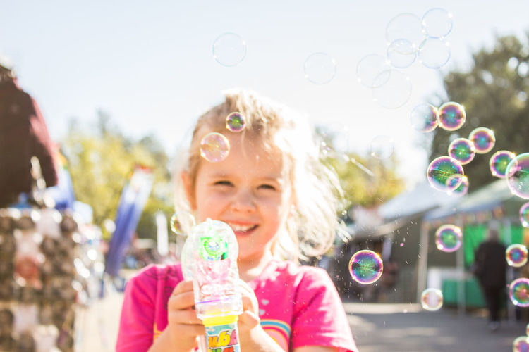 Portrait of smiling girl with bubbles