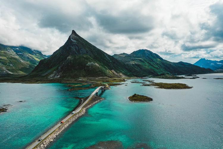 Road with bridges, islands, turquoise ocean and mountain peaks in lofoten, norway