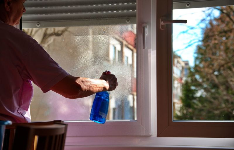 Man working in glass window at home
