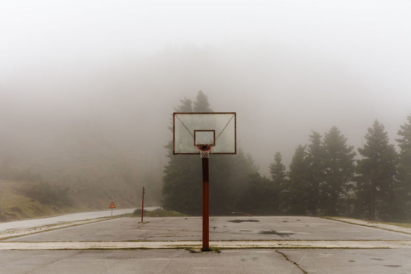 View of basketball hoop in foggy weather