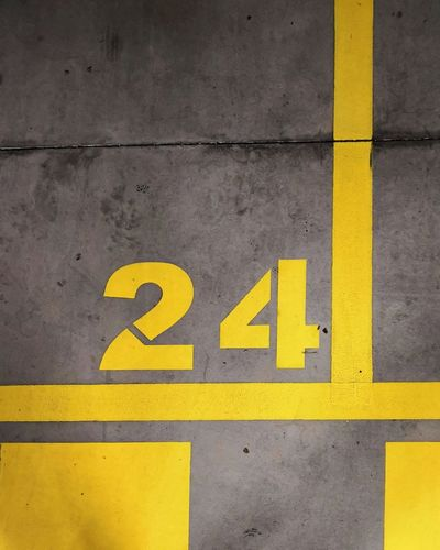 No People 24 Number Parking Garage Place Indoors  Yellow Communication Close-up