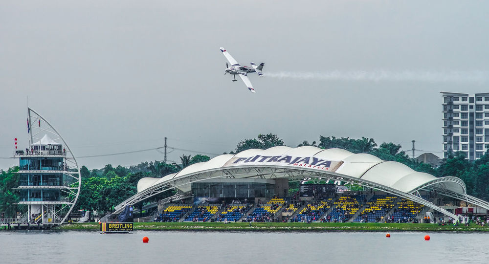 Qualifying session of the Red Bull Air Race World Championship Aerobatics Air Race Aircraft Aviation Challenge Championship Event Extreme Fast Hot Jet Lakeside Mode Of Transport Motion Outdoors Pilot Putrajaya,malaysia Red Bull Sky Smoke Speed Success TakeOff Transportation Wings