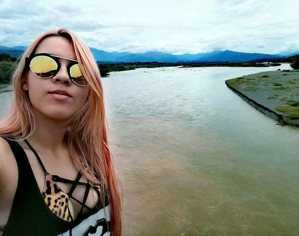 Sunglasses One Woman Only One Person Only Women Water Beauty Young Adult Vacations Sky Nature River River View Río Cauca Santa Fe De Antioquia Puente De Occidente Colombia