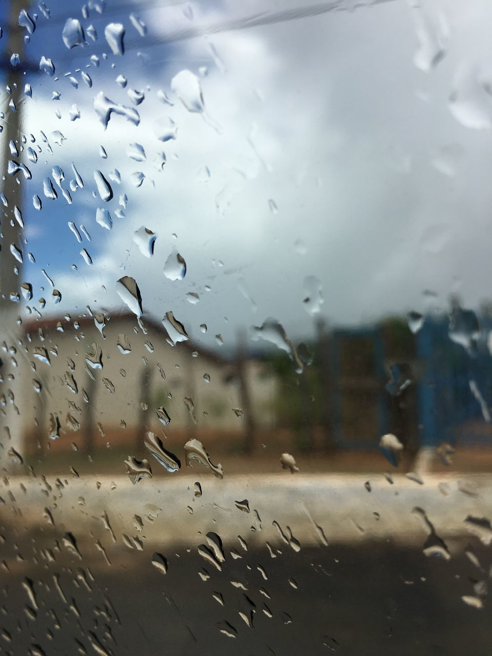 wet, drop, rain, window, glass - material, transparent, water, focus on foreground, raindrop, nature, rainy season, indoors, mode of transportation, close-up, no people, car, transportation, sky, glass
