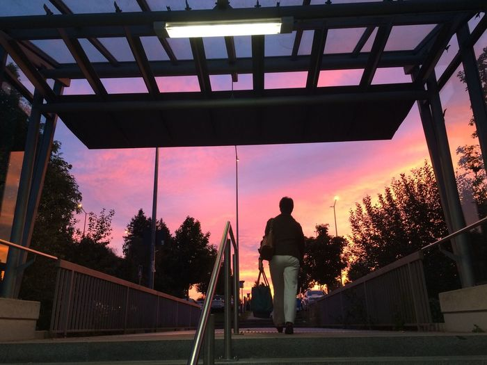 Leaving a Train Station Leisure Activity One Person Real People Lifestyles Tree Silhouette Full Length Men Sport Sky Sunset Built Structure Playing Outdoors Day Skateboard Park One Man Only Adult People Transportation Train Station Evening Sky