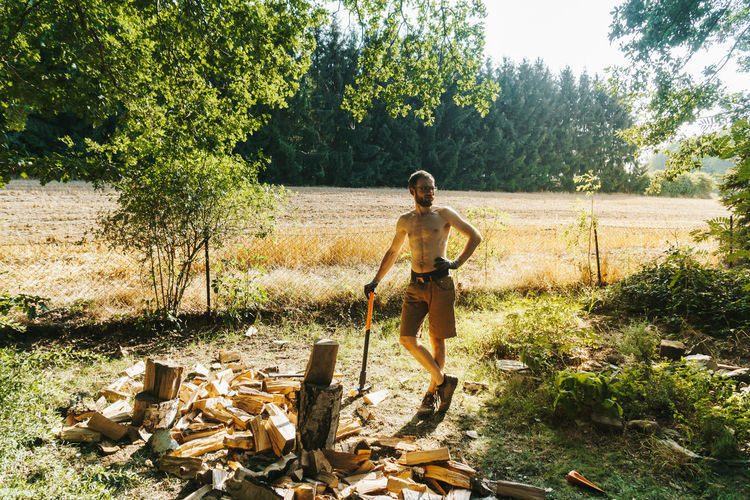 strong man chopping wood Chopped Masculinity Men At Work  Nature Power Wood Woodworker Work Working Action Activity Ax Axe Beard Firewood Garden Leisure Activity Masculine Men Strong Summer Sun Wood - Material Woodwork  Woodworking